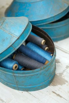 Turquoise vintage tins filled with sea coloured thread.