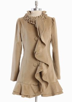 "Charleston Era Ruffle Coat 94.99 at shopruche.com. Vintage inspired, this medium weight coat in tan is accented with statement ruffled detail, tonal button closures, and slit pockets. Fully lined.  Self: 80% Poly, 20% Acrylic, Lining: 100% Poly, Imported, 33"" length from top of shoulder"