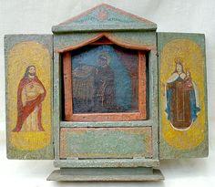 """Nicho limosnero con retablo """"San Antonio""""  Puertas pintadas """"Sagrado Corazón"""" y """"Virgen del   Carmen""""  Colonial venezolano. Siglo XVIII.           Policromado. Medidas: 40 x 47x 8 cms."""