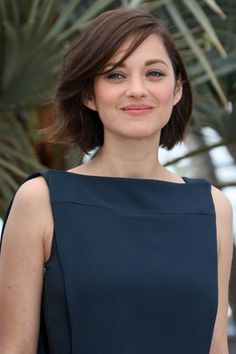 Cannes Film Festival 2013  At a photo call for her film Blood Ties, Marion Cotillard wore her bob parted at one side, with a sweeping fringe. her make-up was simple and natural-looking.
