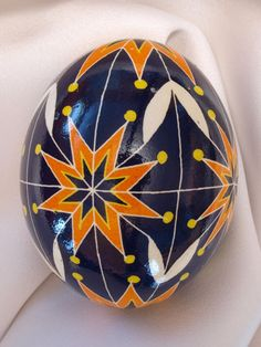 pysanky egg - orange 8-pointed stars.