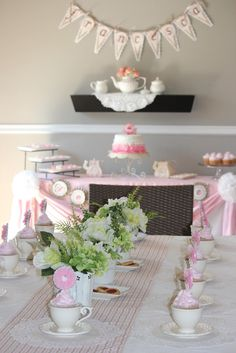 Tea Party with cute ruffle cake and cupcakes in teacups