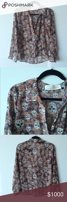 Vintage Havana Sheer Skull Blouse Sheer material. Tags do not indicate fabric but I assume it's polyester. Looks like a button down, but no buttons- top half is open. Measurement: underarm to underarm flat across is approximately 20 inches. Back of neck to bottom of hem is approximately 27 inches. Front is approximately 4 inches shorter when laying flat but will be determined by how it hangs on you. Colors are a peach like background, black and off white skulls. Vintage Havana Tops Blouses