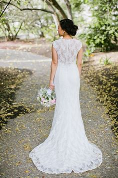 Gorgeous all-lace wedding dress with a subtle but pretty train! | http://www.weddingpartyapp.com/blog/2014/10/03/effortlessly-bridal-pretty-wedding-dresses-with-trains/