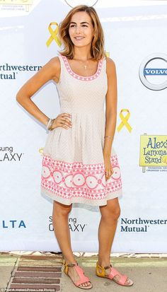 Pretty in pink! The Amapola star was a vision to behold in a patterned pink and white summer frock