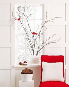 Gather bare branches from the garden, and arrange them in a narrow glass vase…
