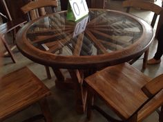 Handcrafted reclaimed wagon wheel teak wood dining table with chairs from Chiang Mai, Thailand