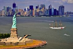 The Coast Guard Cutter Eagle sails toward New York Harbor to anchor at the Statue of Liberty.