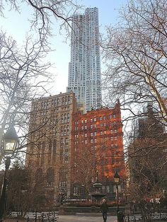 8 Spruce Street, architect Frank Gehry's 76-story steel and aluminum skyscraper (completed in 2010) as viewed from City Hall Park in New York City. March 14, 2014.