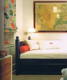 Boys' trundle bed in navy.  Also love the wall map.