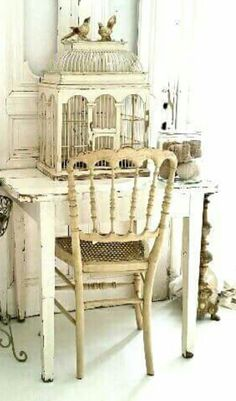 Love the birdcage and white on white palette...