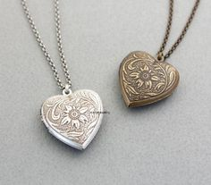 A Beautiful Heart locket with floral pattern in burnised silver and gold plated brass. Vintage style pendant. This one-of-a-kind spiritual nacklace is perfect to wear during the day or a special nigh