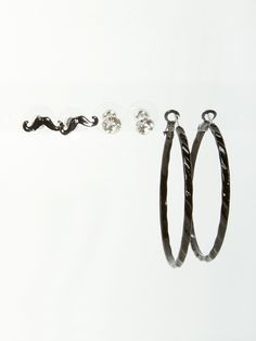 """Update your look this season in these fashion trio earrings featuring mustache, studs, hoops and rhinestone detail. Post back closure on mustache and studs. Wire hook closure on hoops. 1/8""""- 3/8"""" long. Set of 3. Imported. FINAL SALE, NON-RETURNABLE."""
