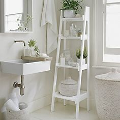 Go with an all-white decorating scheme to make your bathroom feel more spacious. A slim tapering ladder shelf unit, like this from The White Company, provides essential storage. Decorate the bathroom with potted plants and bud vases to add a natural touch Bad Inspiration, Bathroom Inspiration, Interior Inspiration, Bathroom Inspo, Bathroom Ideas Uk, Bathroom Styling, Interior Ideas, Bathroom Ladder Shelf, Ladder Shelves