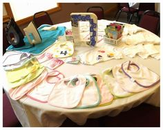Hoyby Crafts: Children's Book-Themed Baby Shower-decorate bibs and onesies using iron-on transfers to give to the mommy-to-be