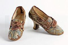 A pair of brocaded silk ladies shoes, circa 1770, the silk circa 1730, with interesting angular, stacked white kid leather 'Italian' heel, 22cm, 8 1/2in. Kerry Taylor Auctions