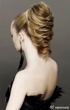 not exactly sure how to do this, but wow! maybe just a high pony tail, some backcombing n braiding.