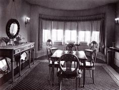 This is the breakfast nook at Pickfair. I can easily picture Mary Pickford and Douglas Fairbanks breakfasting there before heading off to the studios. I like that (what I assume to be) teapot and creamer set on the sideboard, but I'm wondering what those two things are on the floor under the sideboard? Paintings? Mirrors? Oh, and I do wish someone would replace that kaput light bulb on the left.