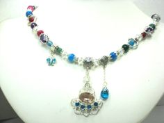 Blue & Pink Topaz Gemstones in Sterling Silver Every bead on this necklace is a genuine Fantastic, GEMSTONE! I Love designing and creating these necklaces. I love all the Amazing Gemstones. They all shine and twinkle when they catch the light. by Chris of FantasyDesign, $107.00