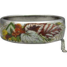This Victorian Silver and Enamel bangle bracelet was made in Vienna, Austria around 1880.  It is enameled with the somewhat unusual…