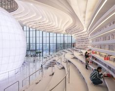 MVRDV complete futuristic Tianjin library with cascading bookshelves and enormous mirrored 'eye'