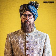 The simplest way to get the look and fit right is to treat the sherwani as an extended bandhgala. Keep the fit straight rather than the traditional flared one.