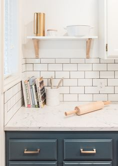 Quartz countertops from @Caesarstoneus and subway tile from @Wayfair gave my kitchen a clean, sleek, and bright look that I can't get over!