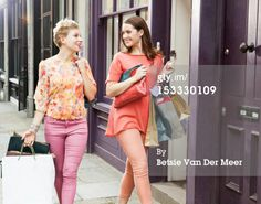 Stock Photo : Women walking with shoppingbags on street.