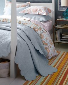 Our Jardin Scalloped Quilt and Sham embodies both modern styling and an heirloom sensibility.