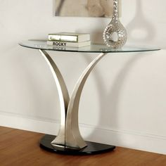 Sofa Table Valo Collection CM4727S These contemporary living room tables feature oval tempered glass tabletops and distinct pedestals, sure to add a modern air to any living space.Contemporary Style8Mm Black Beveled Tempered Glass TopV-Pedestal Metal For $229.00