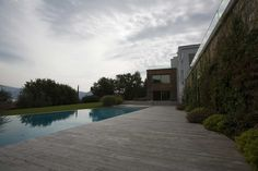 Clusane. The design on Iseo Lake shore. Exterior and Interior design are joined up for a lake garden.