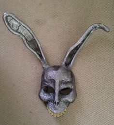 Home made Donnie Darko 'Frank' mask made from a skull mask, papier mache and items from a thrift shop. The ear shapes were made from soft, bendable rubber equipment ties and cardboard. The teeth were cheap false finger nails.