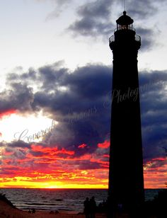 This is a sunset at Little Sable Light House, at Silver lake , Lake Michigan