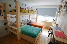 lower the top bunk, do trundle twin beds under and maybe stairs to top bunk for the three girls.