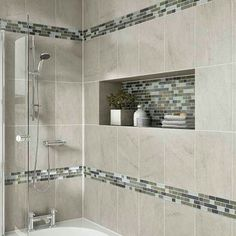 Probably our favorite use of accent tile. We use quality products from Daltile when remodeling bathrooms in the Central PA area. Consider the rich look of tile and recessed shelving when considering your bath or shower remodel. Shower Remodel, Shower Tub, Bathroom Shower Tile, Bathroom Makeover, Bathroom Shower, Bathrooms Remodel, Bathroom Design, Bathroom Decor, Beautiful Bathrooms