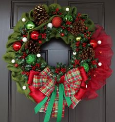 "This beautiful wreath is made on a 14"" straw wreath base and measures between approximately 23"" in its shortest diameter and approximately 23"" in its widest diameter, ribbon to ribbon and 6"" deep. This wreath is just GORGEOUS !!! Must see to believe! The picture just can't tell it all!"