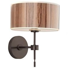 "Wall sconce in sienna bronze with woodgrain-inspired drum shade.Product: Wall sconce  Construction Material: Acrylic  Color: Sienna    Features:  Includes 5"" non-IC housing and shower trim    Distinctive streamlined silhouette     Accommodates: (1) 60 Watt A-19 medium base bulb - not included        Dimensions: 12.375"" H x 9.875"" W x 10.5"" D"