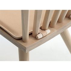 Here is a simple solution to chair cushion stability! I like the nice clean look of the little curved dowel!