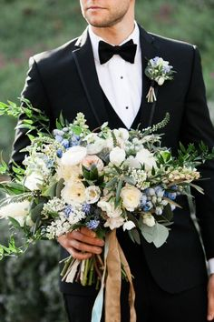 Wedding Bouquets Groom holding the bride's bouquet. Photography: Gloria Mesa Photography - Groom holding the bride's bouquet. Bridal Flowers, Flower Bouquet Wedding, Floral Wedding, Wedding Colors, Wedding Blue, Delphinium Wedding Bouquet, Rustic Wedding Bouquets, Blue Wedding Flower Arrangements, Wild Flower Wedding