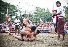 Rakhine men play kyin, a traditional form of wrestling, at the Rakhine State Day in Yangon, Myanmar Photo: Thiri Lu
