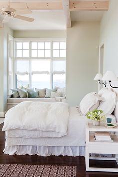 The wood floors, beamed ceiling and the cozy window seat make this space so enticing.  #country living #dream bedroom