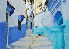 A blue street in Chefchaouen Morocco Holiday Marrakech, Blue City Morocco, Morocco Chefchaouen, Moroccan Blue, Visit Morocco, French Colonial, Art Deco Buildings, Cheap Holiday, Night Life