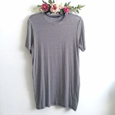 [128] Brandy Melville Striped T-Shirt Dress A classic Brandy dress that is soft, flowy (NOT TIGHT FITTING), and inches in length. Worn once, in amazing condition! Brandy Melville Dresses