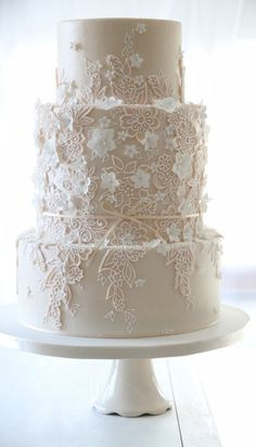 Three tier lace effect wedding cake by The Enchanting Cake Company                                                                                                                                                      More