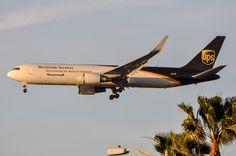 UPS 767-300F, N323UP, making a case for gold and brown going well together on March 9, 2016.