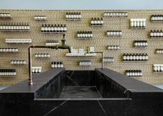 Soapstone sink, taps are fixed to exposed copper pipes. Aesop East Hampton