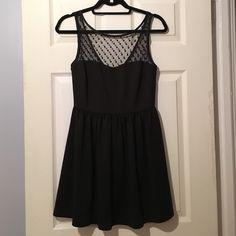 Flirty black dress Sweetheart neckline with mesh overlay. V cut back. Black. Dresses