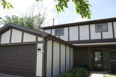 Cobblestone stucco with custom color trim.  Khaki lap siding and Terra Rose Versetta Stone