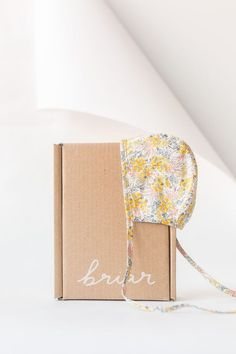 As delightful as the first glimpse of vivid spring flowers, Goldie is the bee's knees. Baby bonnet handmade from Liberty of London floral cotton and lined with 100% cotton, we only use the best for this sweet necessity.