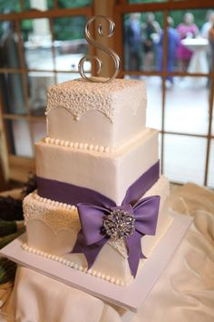soft gold color wedding cake with buttercream frosting and with a navy or teal ribbon to match my wedding colors!!!